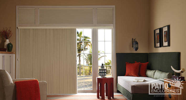 Single-cell motorized cellular shades on top and SlideVue cellular shade