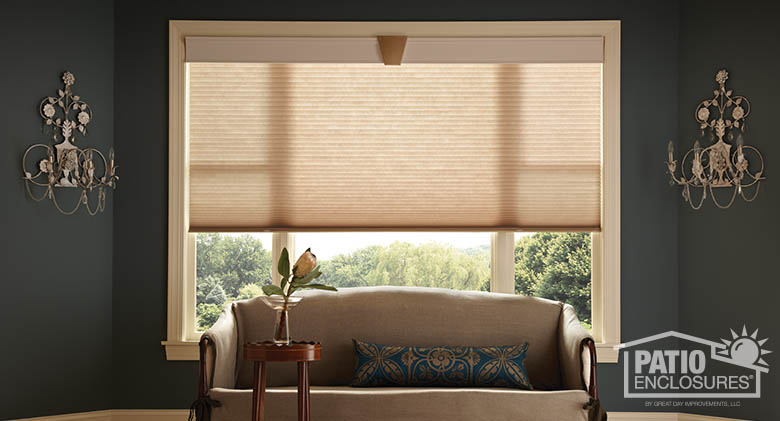 Cordless cellular shades in taupe with antique Regal wood cornice