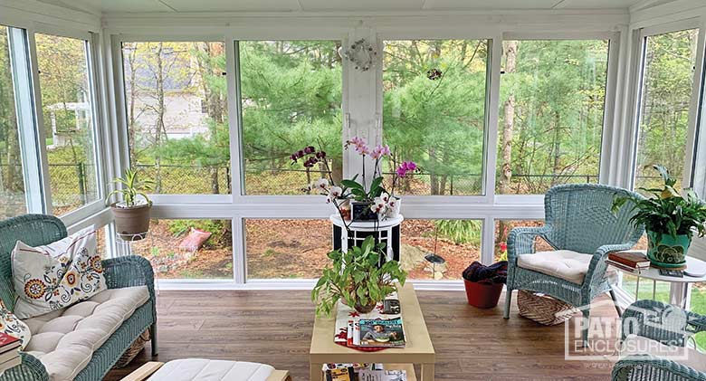 White four season sunroom with vinyl frame, glass knee wall and single-slope roof.