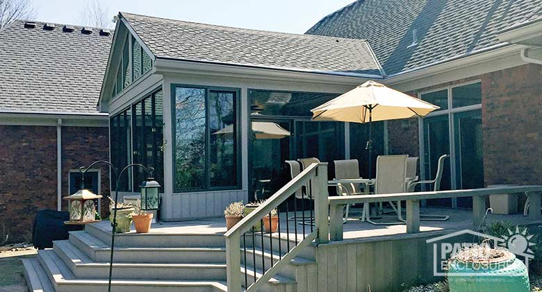 Bronze all season sunroom with aluminum frame enclosing an existing covered porch.