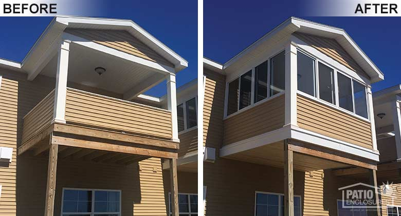 White elite three season room enclosing an existing second-story covered porch in an Amedore Homes development.