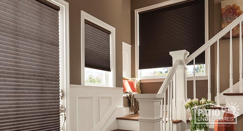 Cellular shades with cordless lift, Solitude blackout fabric, and walnut shell.