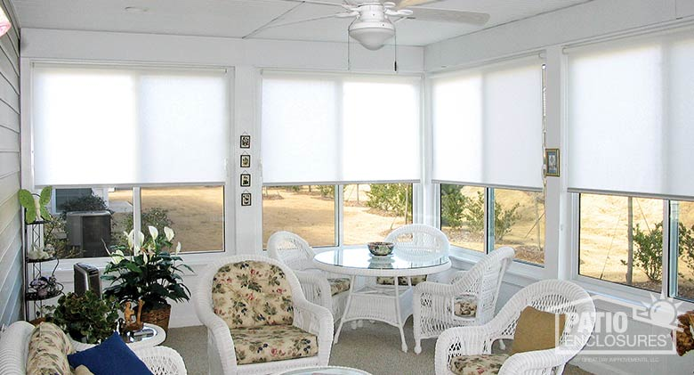White roller shades provide privacy and control light.