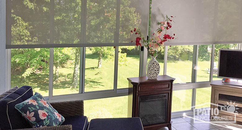 Roller shades can be adjusted as needed to control natural light.