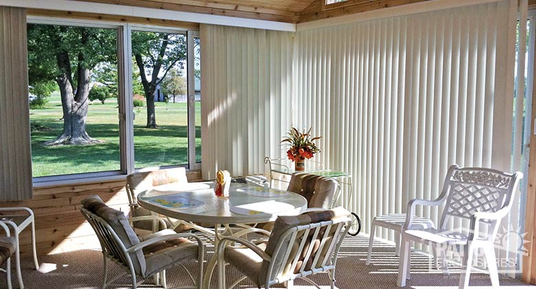 White vertical blinds can be fully opened for expansive views.