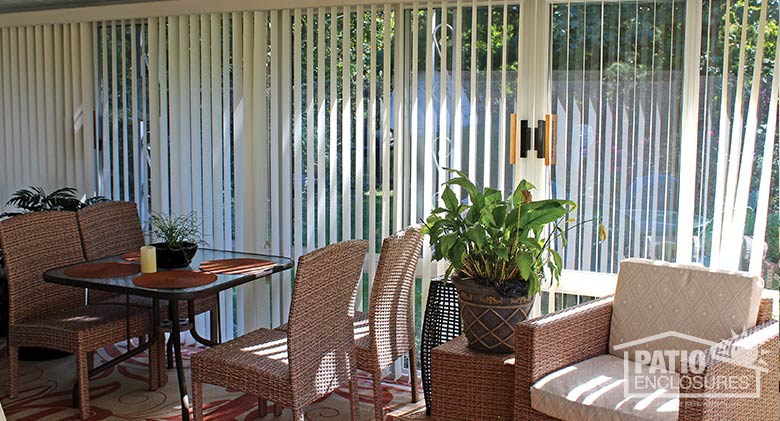 White vertical blinds provide privacy and UV protection.