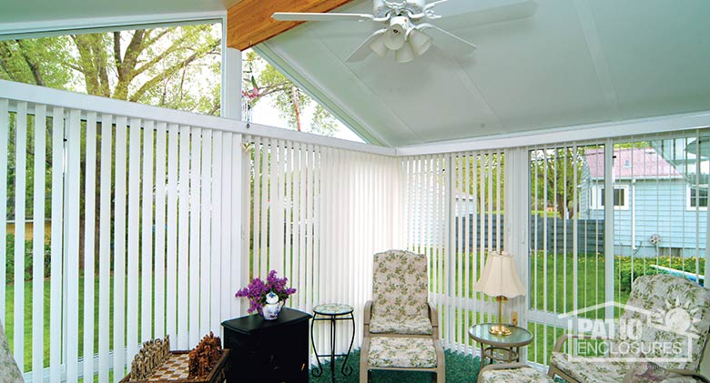 White vertical blinds provide privacy while open glass in a gable roof allows for ample natural light.