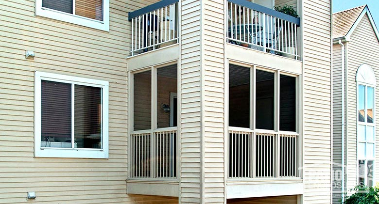 Screen room in sandstone with picket railing system enclosing existing covered porch in West Trenton, NJ.