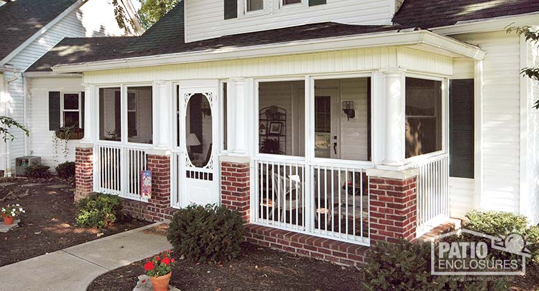 Screen room in white with picket railing system enclosing an existing front porch.