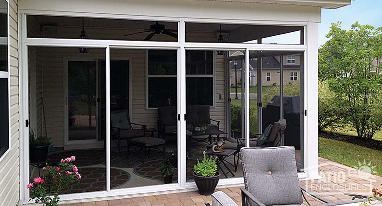 Screen room in white with transom enclosing an existing covered patio.