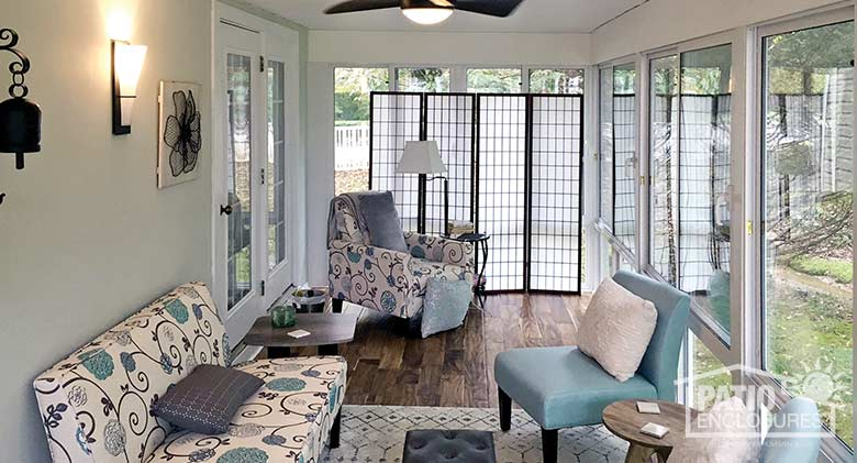 Elite three season room enclosing an existing screened porch.