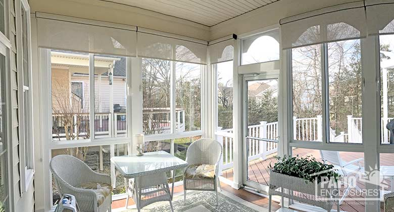 Elite three season room in white with glass knee wall enclosing an existing screened porch.