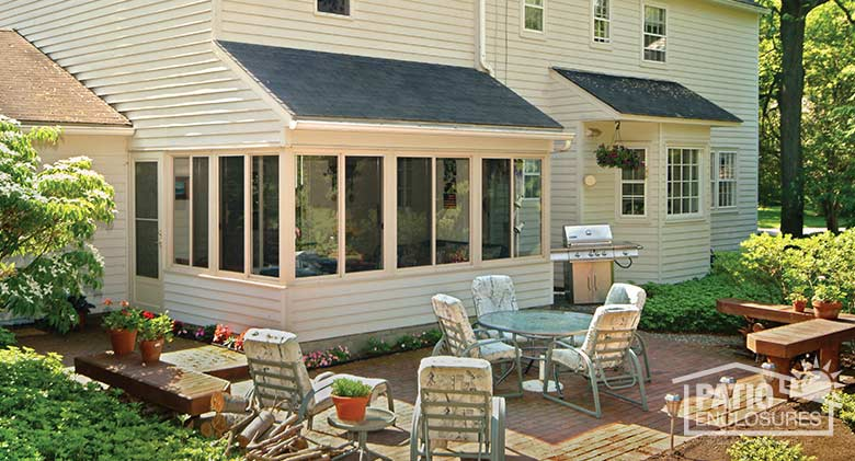 Three season room in white with solid knee wall enclosing an existing covered porch.