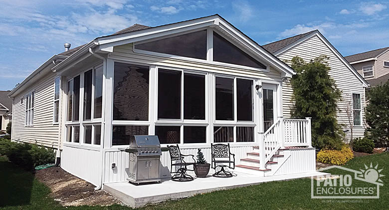 Four season vinyl sunroom with glass wings in gable roof, and glass knee wall