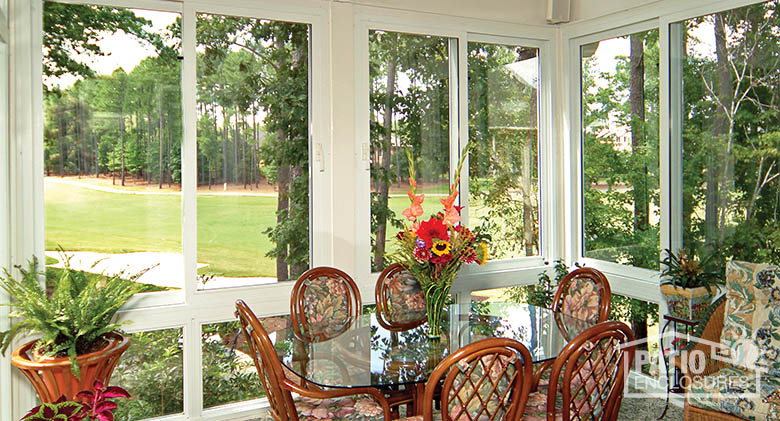 Vinyl four season sunroom with gable roof and glass knee wall