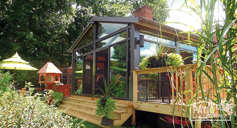 Bronze four season sunroom with aluminum frame, transoms and gable roof.