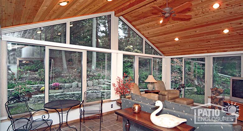White four season sunroom with aluminum frame, solid knee wall and custom gable roof.