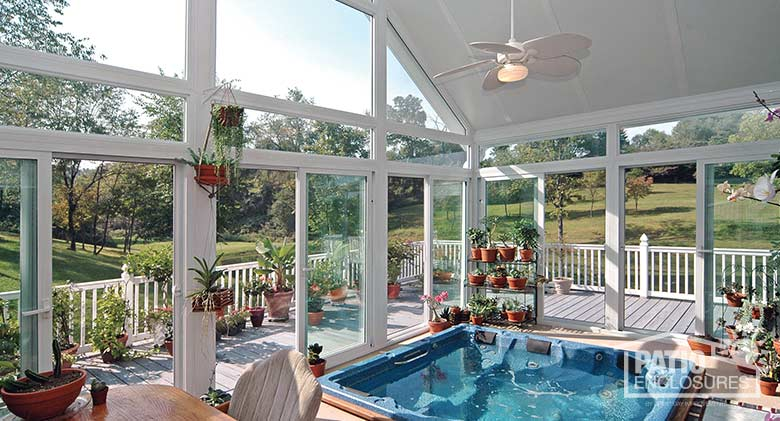 Interior view of four season sunroom with vinyl frame, transoms and gable roof.