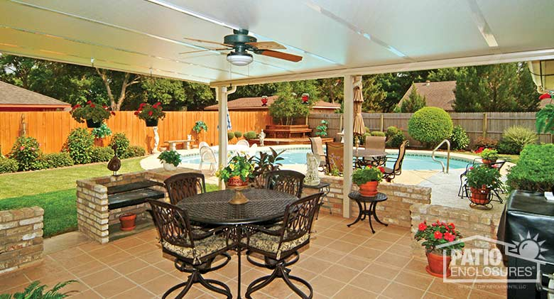 View Of Pool From Under Sandstone Patio Cover Interior