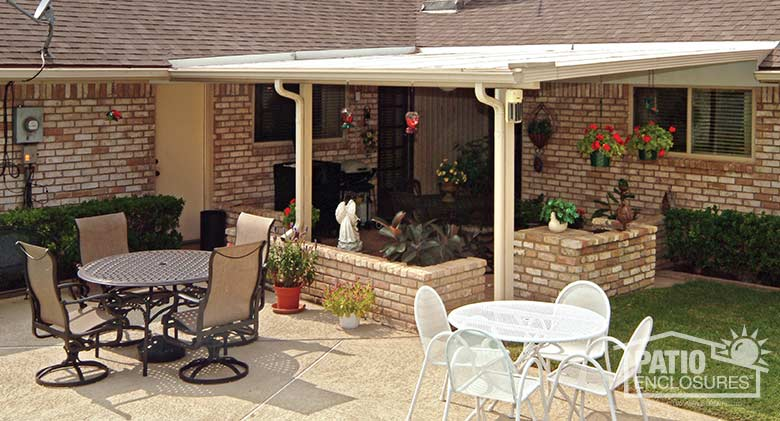 "Sandstone patio cover with existing knee wall planters creates an outdoor ""room."""