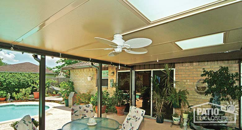 Sandstone patio cover with glass roof panel for added light interior