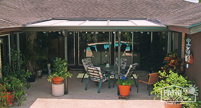 sandstone patio cover with glass roof panel for added light exterior - Cover Patio