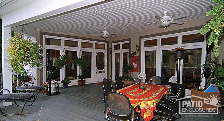 White porch cover with ceiling fans for maximum comfort