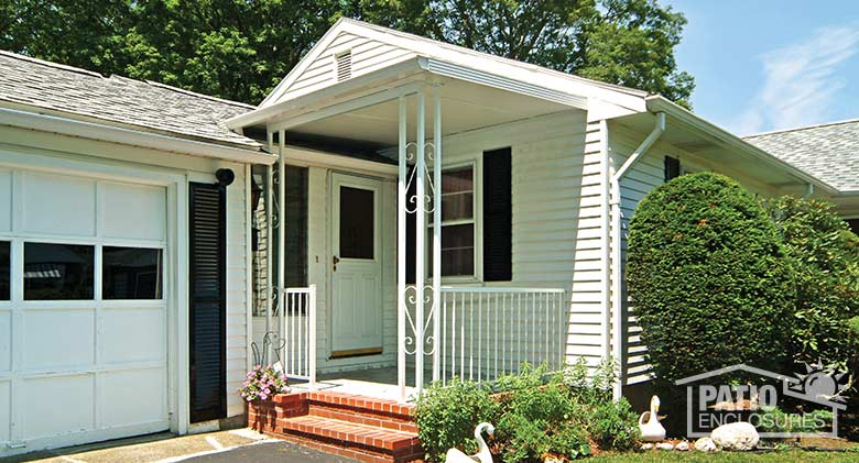 White porch cover provides protection at the front door.
