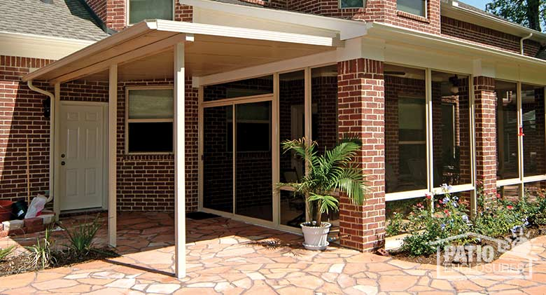 Sandstone patio cover attached to existing roof of enclosed porch.