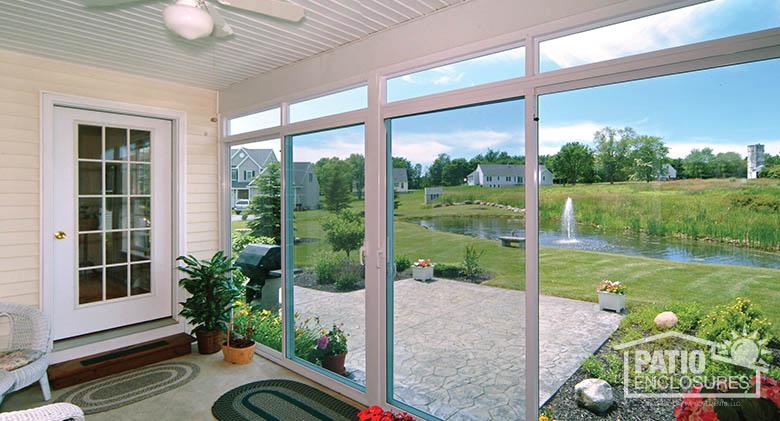 back porch enclosure with white aluminum frame interior