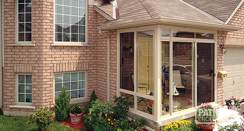 Front porch enclosure with sandstone aluminum frame.