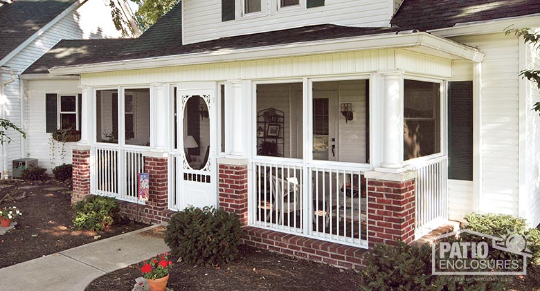 White screen room with picket railing system enclosing a covered front porch.