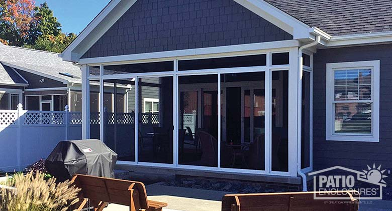White screen room with transom enclosing existing covered patio.