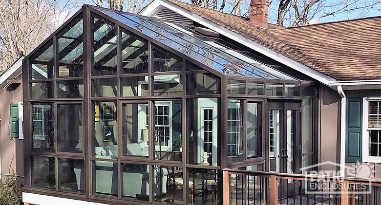 Bronze solarium with gable roof.