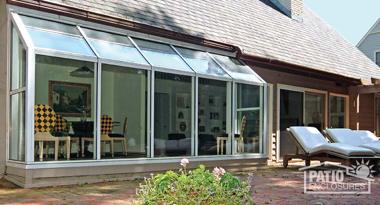 White solarium with single-slope roof.