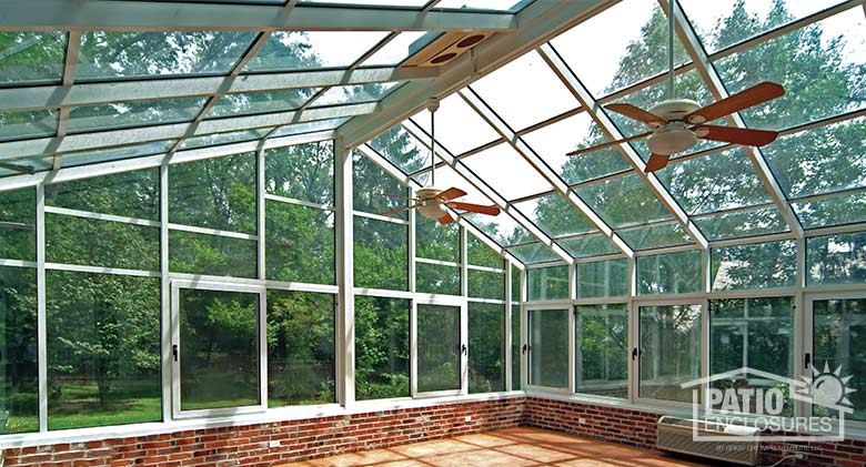 White solarium with aluminum frame and gable roof.