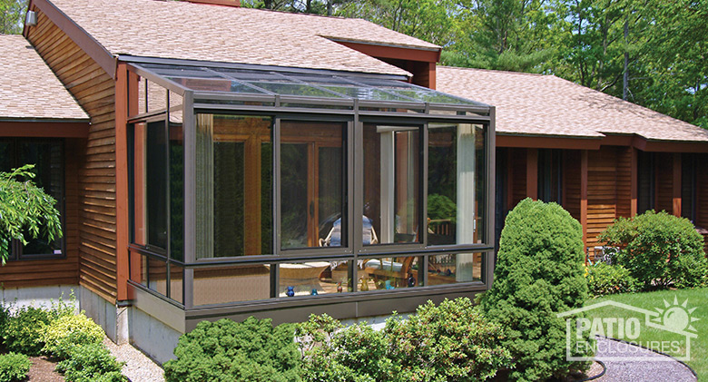 Single-slope, straight eave solarium with bronze extruded aluminum frame.