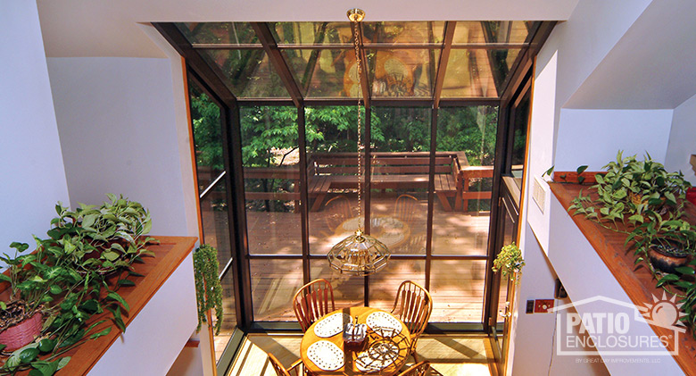 Interior of a single-slope, straight eave solarium with bronze extruded aluminum frame.