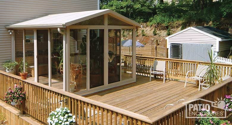 EasyRoom sunroom kit in sandstone with gable roof and glass wings