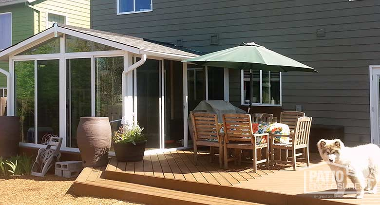 EasyRoom sunroom kit with white aluminum frame and gable roof.
