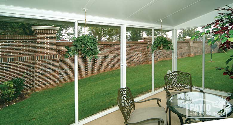 EasyRoom sunroom kit with white aluminum frame and single-slope roof.