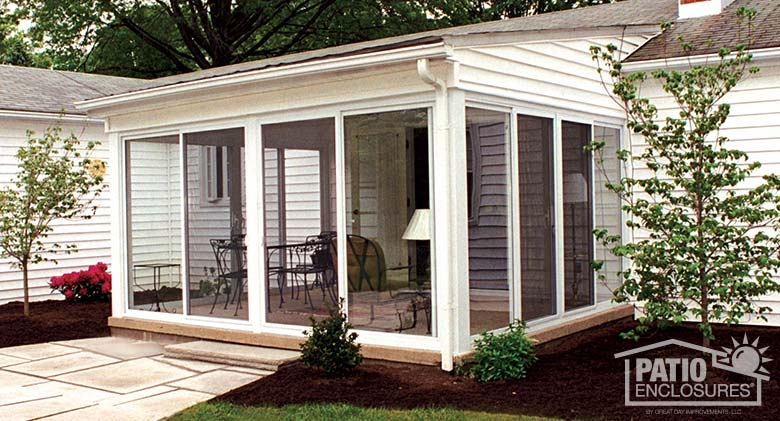 White three season sunroom with single-slope roof.