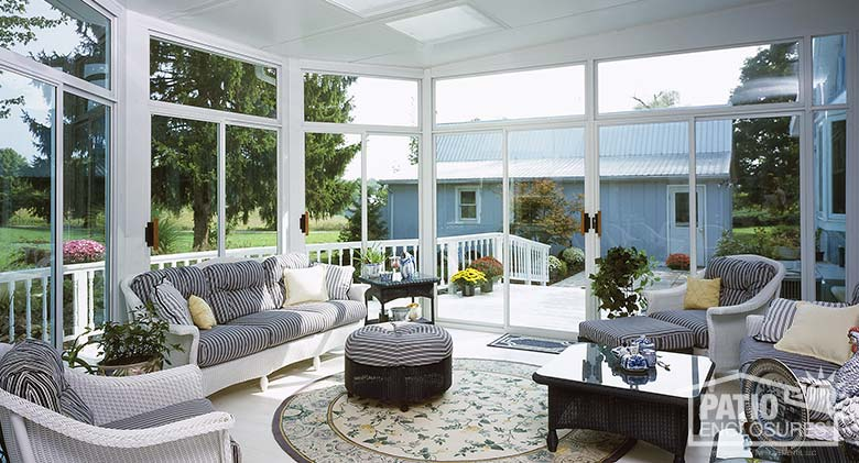 White three season room with transoms and glass roof panels.