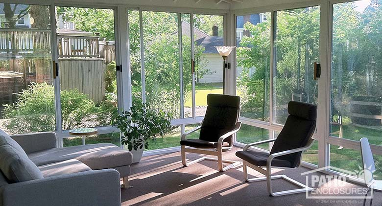 White three season room with glass knee wall enclosing an existing covered patio.