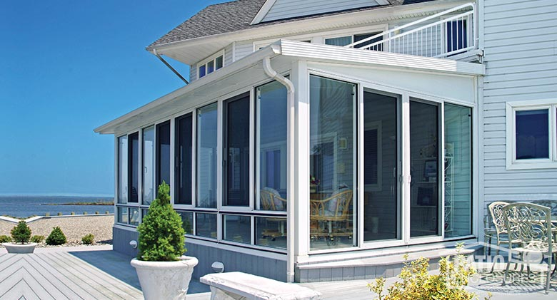 White Aluminum Frame Three Season Sunroom with Single-Slope Roof
