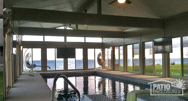 Traditional sunroom provides expansive views while it provides shelter for this indoor pool