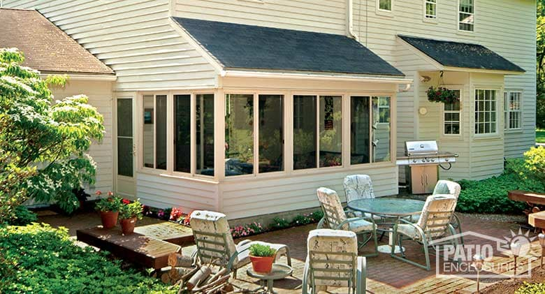 Traditional sunroom with shingled, single-slope roof
