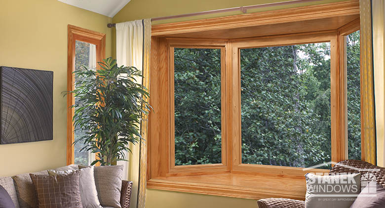 A bay window with woodgrain interior finish adds charm to any room