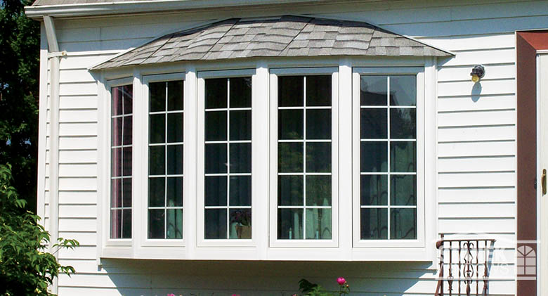 A 5-lite bow window with shingled hip roof