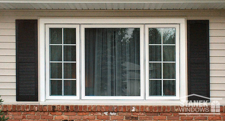 White casement windows with interior colonial grids